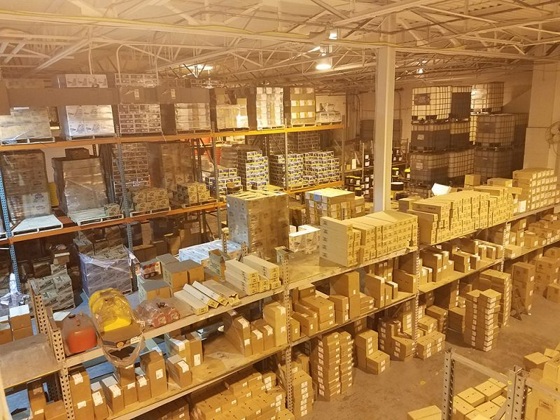 The Young's Lubricants warehouse filled with boxes of filters, batteries, wiper blades, washer fluid, anti-freeze, and Diesel Exhaust fluid.